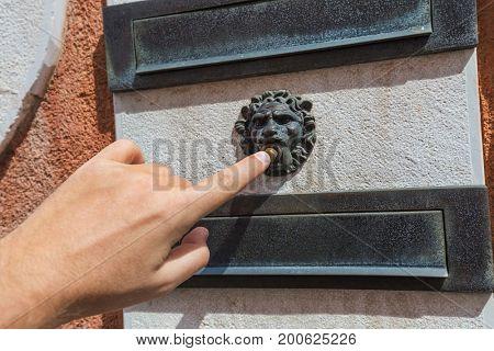 Hand and retro doorbell in Venice