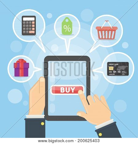 Buying with tablet. Hands holding tablet with buy button on screen. Calculator and card, gift and price tag.