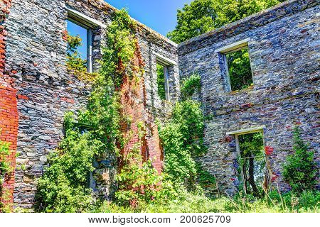 Goddard Mansion stone fortress ruins by Portland Head Lighthouse in Maine during summer