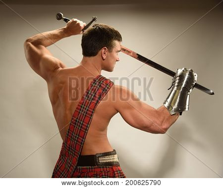 The hot guy is wearing a Scottish kiln.