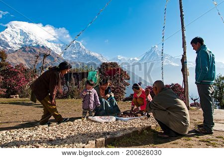 Pokhara, Nepal - March 13, 2013: People Of Tadapani Village In The Early Morning With Beautiful View