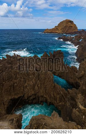 Lava pools in Porto Moniz - Madeira Portugal - travel background