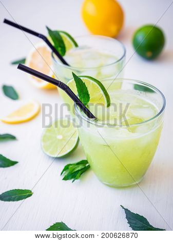 Fresh citrus lemonade made of limes and lemons in glasses.