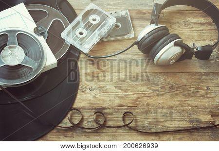 Retro music background vinyl records film reel audio cassettes headphones