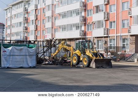 Machinery Dismantle The Rubble After A Fire In A Café On The Territory Of Hotel Complex