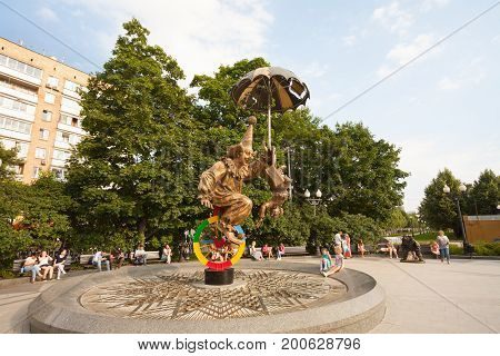 MOSCOW RUSSIA - AUGUST 12 2017: People are sitting near Clowns sculpture on beautiful summer sunny day in Tsvetnoy Boulevard. This sculpture is located near the Moscow Circus.