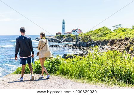 Cape Elizabeth, Usa - June 10, 2017: Young Couple Walking On Trail By Edge Of Cliff Rocks At Portlan