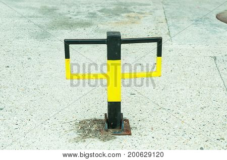 Metal barrier for private outdoor parking lot.