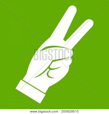 Hand showing victory sign icon white isolated on green background. Vector illustration