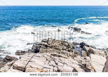Cliff Rocks By Trail In Fort Williams Park In Cape, Elizabeth Maine During Summer Day