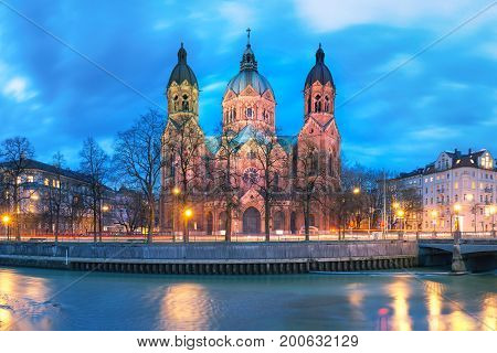 Saint Lucas Church, the largest Protestant church in Munich, and Isar River at night, Bavaria, Germany