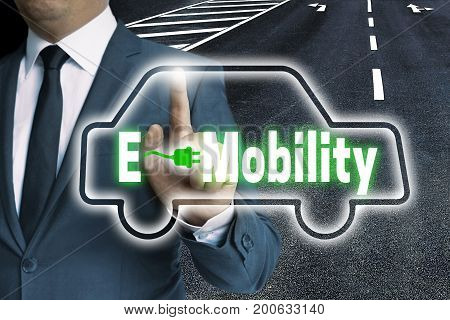 E-mobility Touchscreen Is Operated By Man Concept