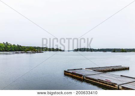 Blue Hill, Maine Empty Harbor During Rainy, Cloudy Weather With Wooden Dock