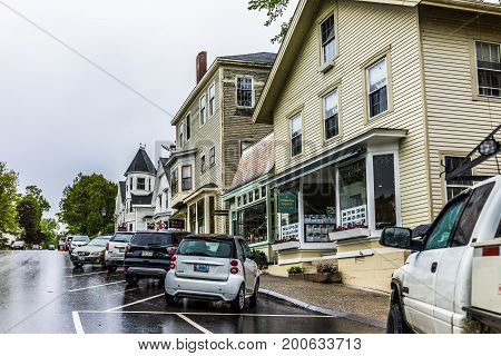 Castine USA - June 9 2017: Empty small village in Maine during rain with buildings on steep hill main street