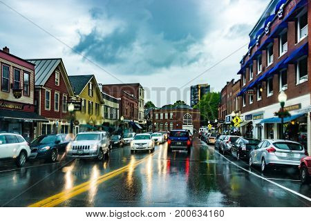 Camden USA - June 9 2017: Downtown small village in Maine during rain with stores on main street