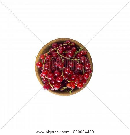 Currant isolated on white background cutout. Red currant in a wooden bowl with copy space for text. Top view.