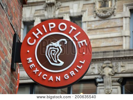 BOSTON USA - OCTOBER 21 2014 : Chipotle Mexican Grill signboard on the wall in Boston. Chipotle is a chain of American restaurants serving mexican food