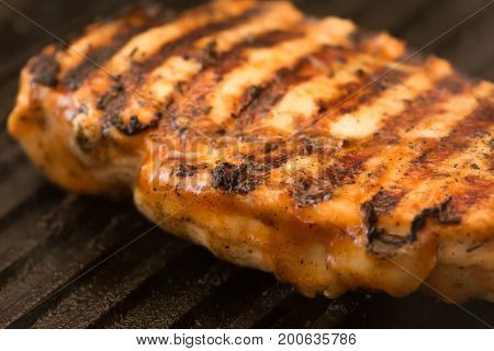 preparing chicken breast stake on a pan grill