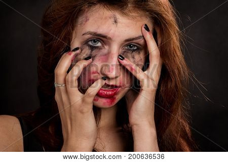 sad woman with smeared make up looking at camera