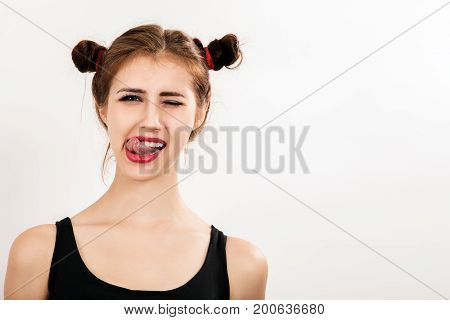 fun girl lick her lips on a white background with copy space