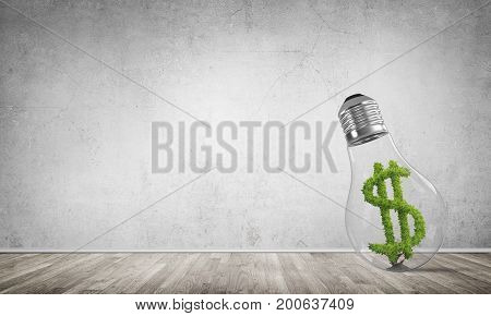 Glass lightbulb with green dollar symbol inside in empty room with grey wall on background. 3D rendering.