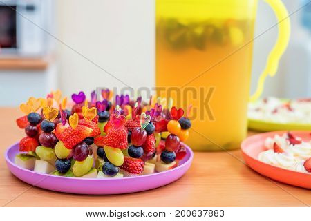 Close up image of delicious fruit snack on skewers