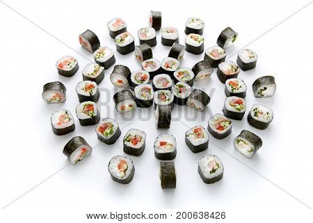 Big party sushi set isolated on white background. Japanese food delivery and take away. Tuna, salmon, seabass and vegetable rolls