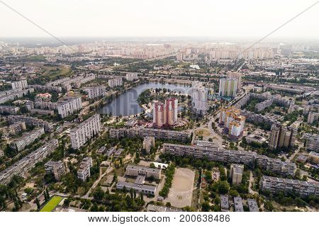 Residential district in a large metropolis with road junctions and houses. Aerial view. From above.