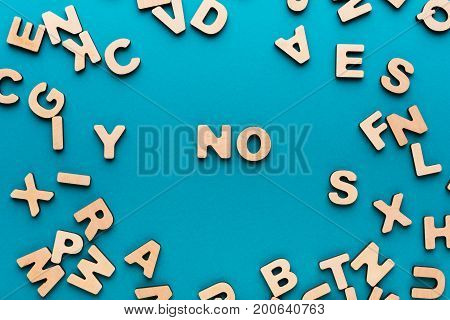 Word No on blue background in wooden letters frame. Refusal, denial, negation concept