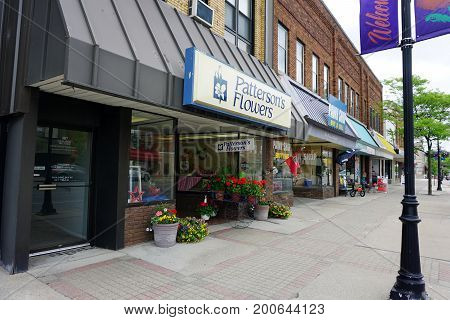 CADILLAC, MICHIGAN / UNITED STATES - MAY 31, 2017:  One may purchase flowers at Patterson's Flowers, on Mitchell Street in Downtown Cadillac.