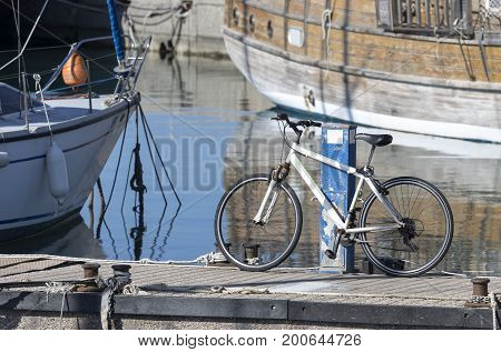 Bicycling on the quay close up on a background of yachts and the sea
