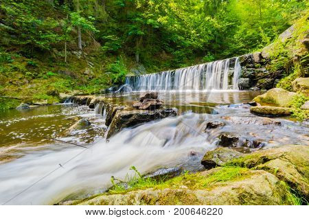 Beautiful Small Waterfall On Nice Creek In Forest