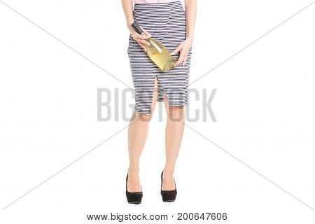 Legs of a young girl in tuffle bottles of wine on a white background isolation