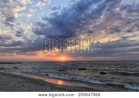 Rays of the rising sun make their way through the clouds on the Black Sea
