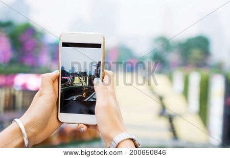 Girl Taking Picture With Smart Phone Of Guangzhou Modern Environment