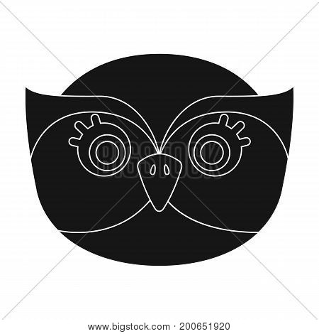 Owl muzzle icon in black design isolated on white background. Animal muzzle symbol stock vector illustration.