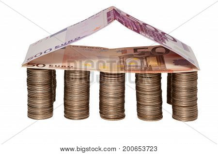 Euros and coins arranged as house with columns on white background isolated