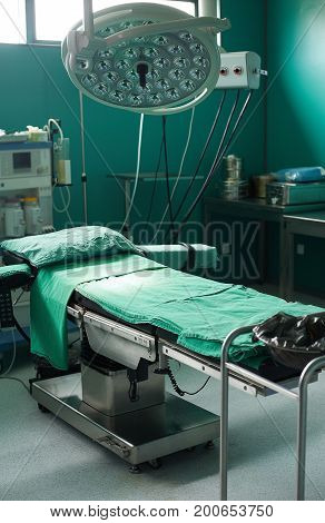 Surgery room in hospital, bed, light and equipment