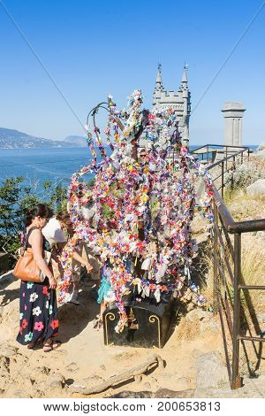 Yalta, Crimea - 11 July, The symbolic tree of desires on the top, 11 July, 2017. Small Castle Lastochkino Nest and its surroundings.
