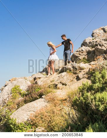 Yalta, Crimea - 11 July, Young couple on a rock, 11 July, 2017. Small Castle Lastochkino Nest and its surroundings.