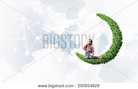 Cute kid girl sitting on green moon and social connection concept