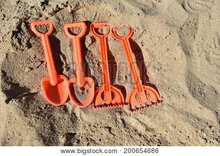 Plastic children toys in sandpit