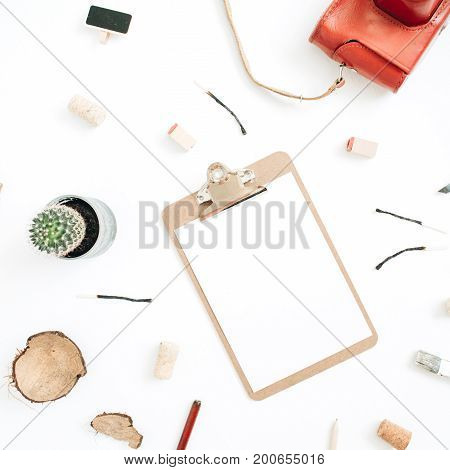 Retro camera succulent tools for handmade arts clipboard with blank paper on white background. Top view flat lay hipster artist concept.