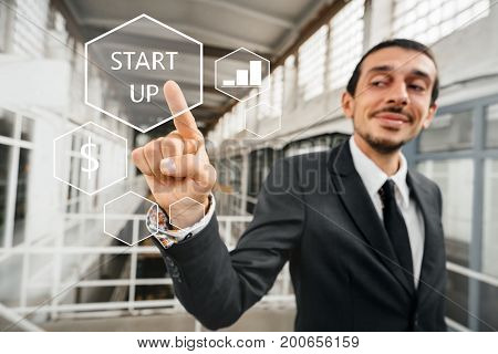Businessman pointing with his finger at the abstract business chart with the word