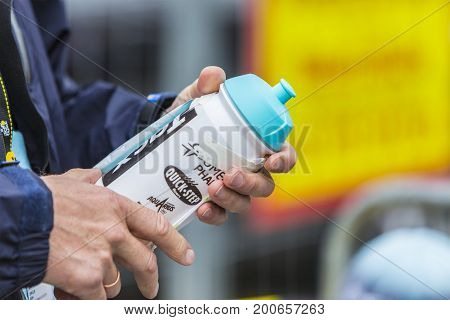 Col du Lautaret France - July 19 2014: Close-up image of hands holding a cylcling revitalization kit on Col du Lautaret in Alps during the stage 14 of Le Tour de France 2014.