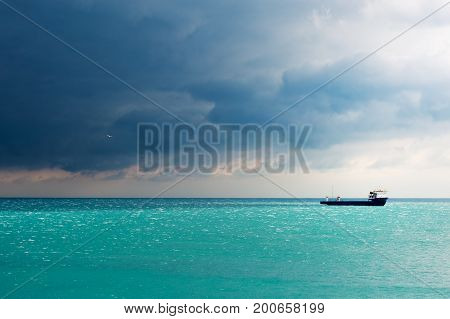 Storm gathering above commercial vessel in Black Sea