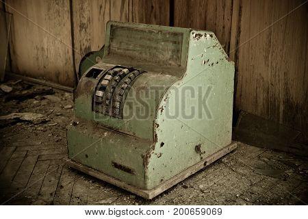Rusty ruined soviet cash machine in abandoned railway station