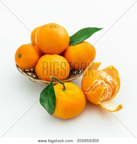 Mandarin in a plate isolated on white background. Flat lay, Top view