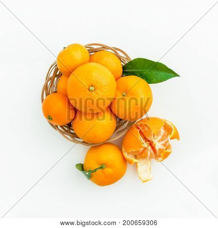 Mandarin in a plate on white background. Flat lay, top view