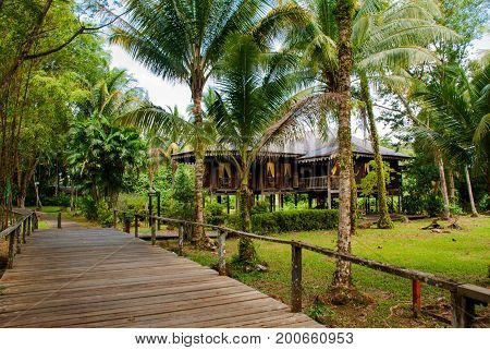 Traditional Wooden Houses And Wooden Road. Kuching To Sarawak Culture Village. Malaysia